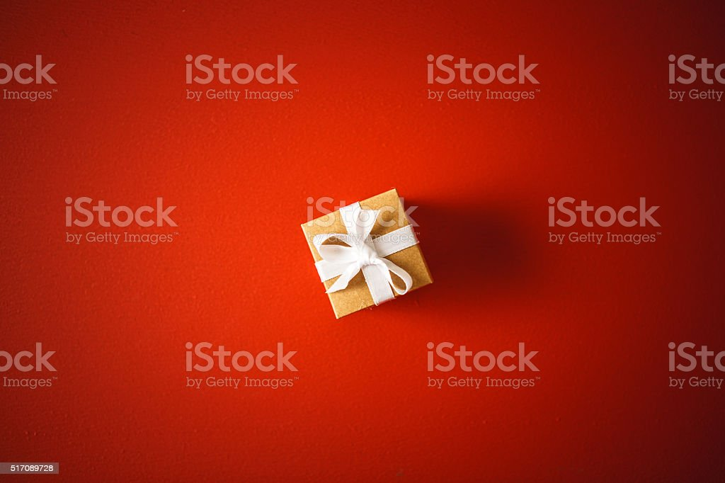 Gift box on red background stock photo