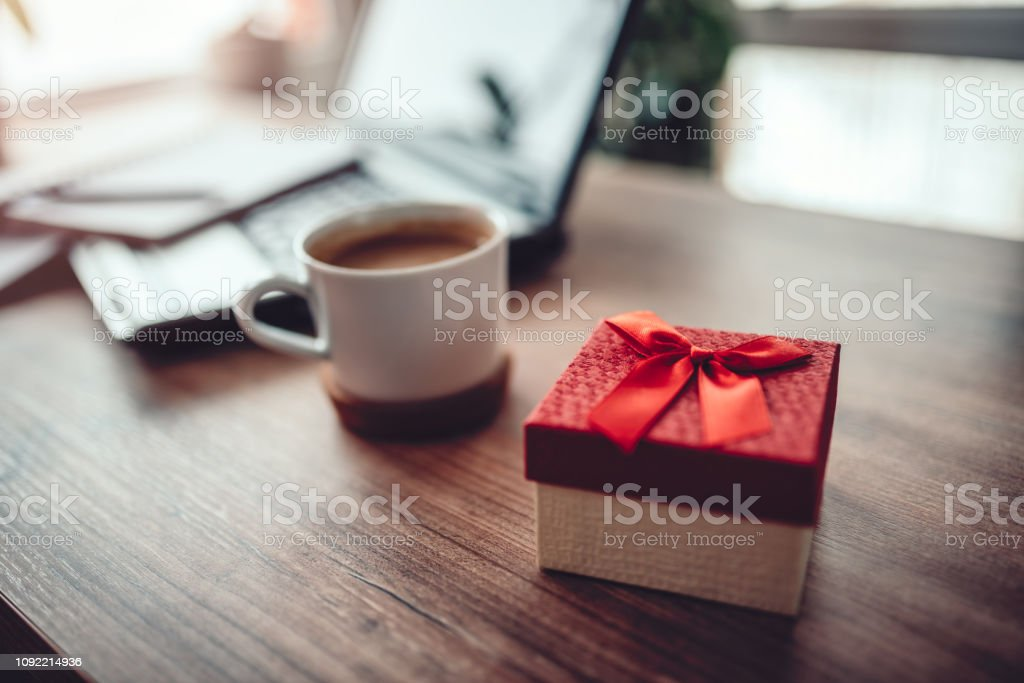 Red gift box on the office desk