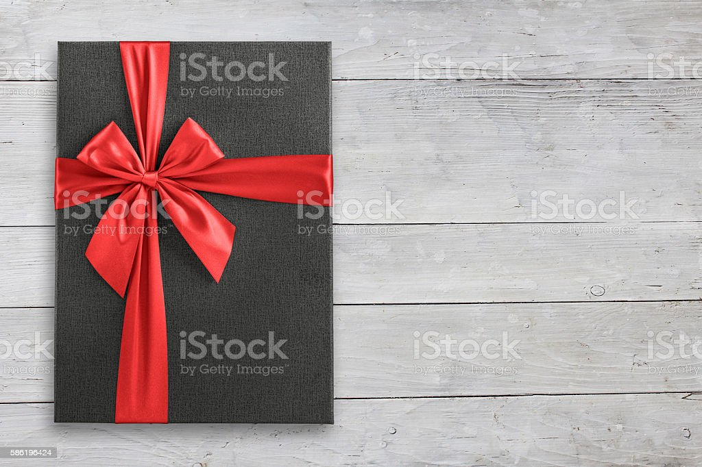 Gift box on white wood view from above stock photo