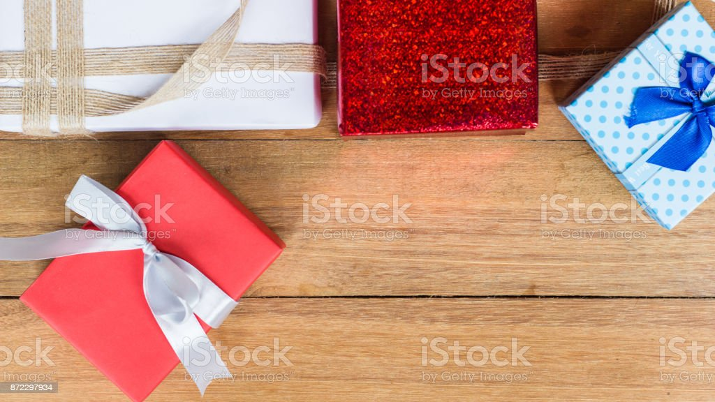 Gift box on wood table background from