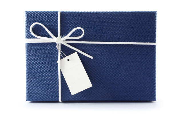 gift box or present box with white rope bow and blank tag isolated on white background with shadow - wrapping paper stock photos and pictures