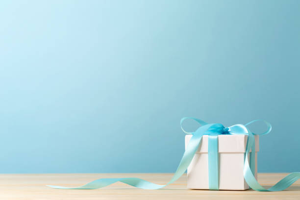 A gift box A gift box on a blue background gifts stock pictures, royalty-free photos & images