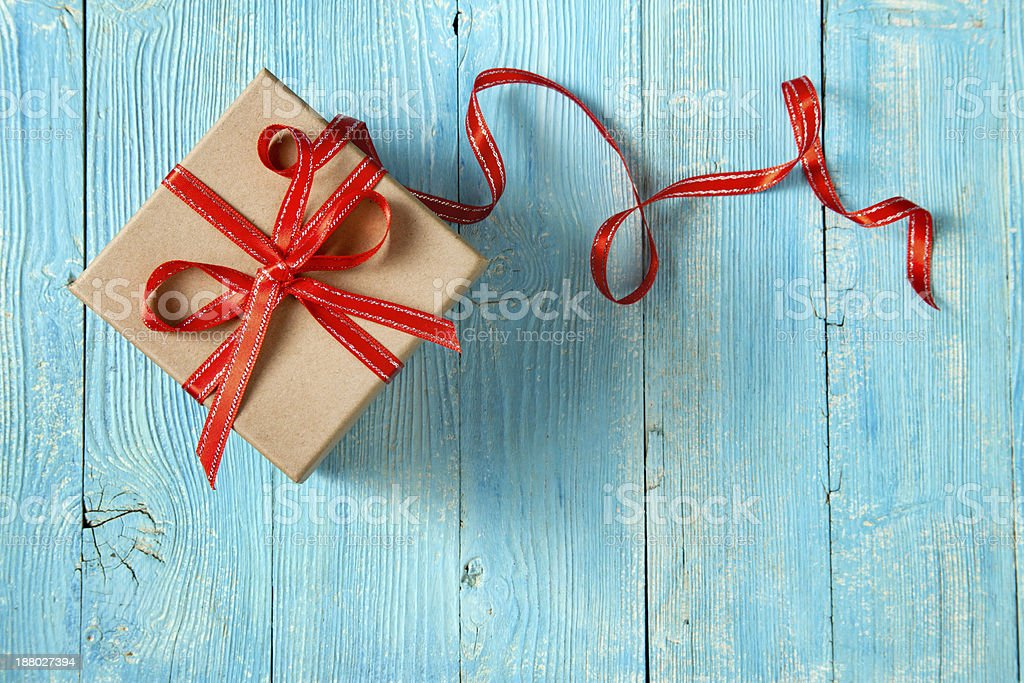 Gift box Gift box with red bow on wooden background Advertisement Stock Photo