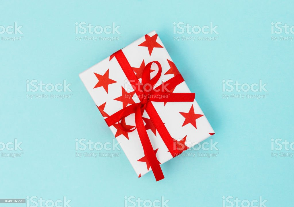 Gift box red stars on blue background. Voucher gift card concept