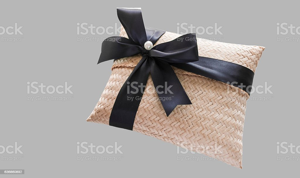 Gift box make by handmade weave, and tied with black ribbon
