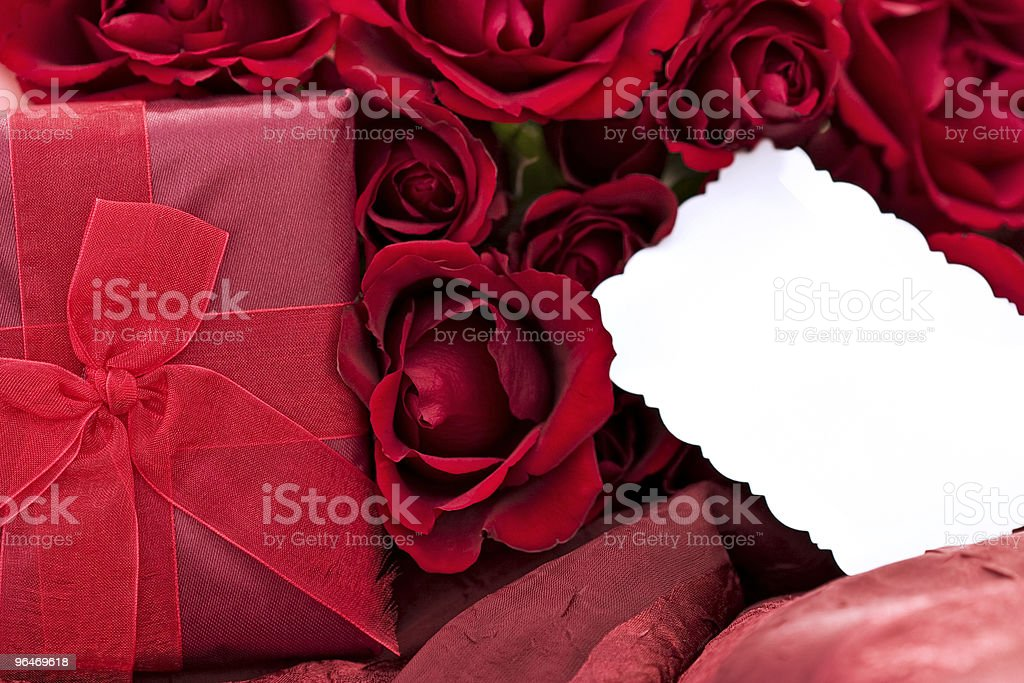 Gift box with a dozen red roses and blank card royalty-free stock photo