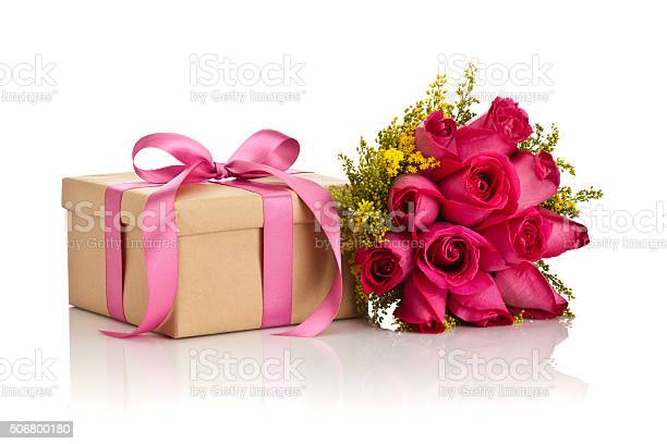 Gift box with a pink bow and a roses bouquet picture id506800180?b=1&k=6&m=506800180&s=612x612&h=vykov9y8gfataqvessakg7spwljjdxyafiyobrkaa6q=