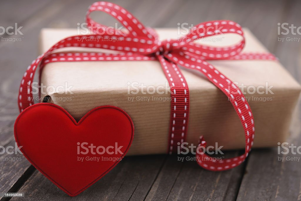 Gift box with a red heart royalty-free stock photo