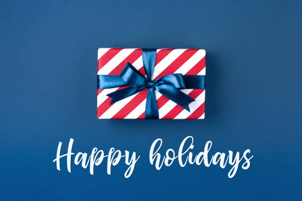 gift box with blue ribbon. - happy holidays stock pictures, royalty-free photos & images