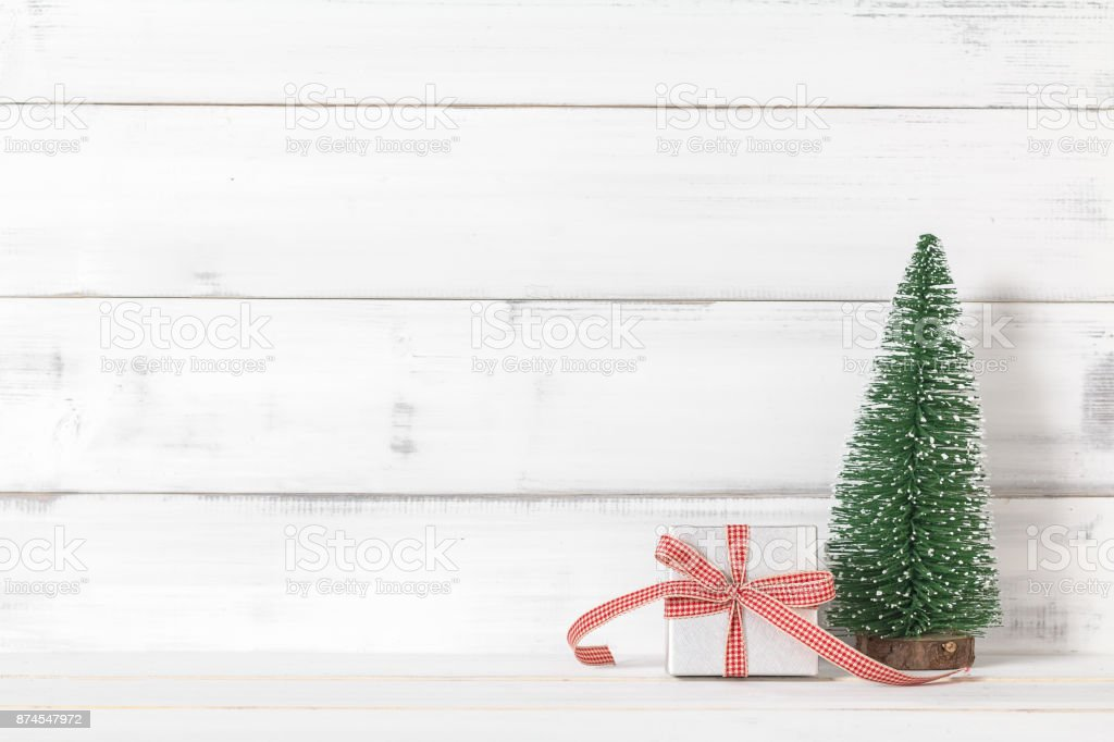 Gift Box With Christmas Tree On White Wood Over White Rustic