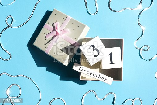 istock Gift box with cubes with the date of the new year. 1175526661