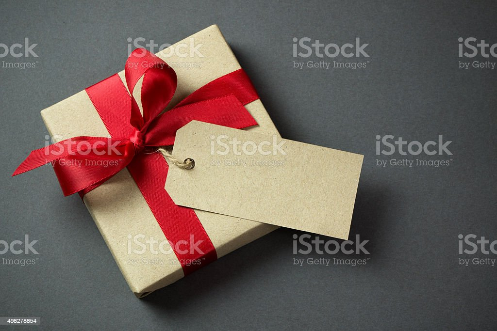 Gift box with empty tag stock photo