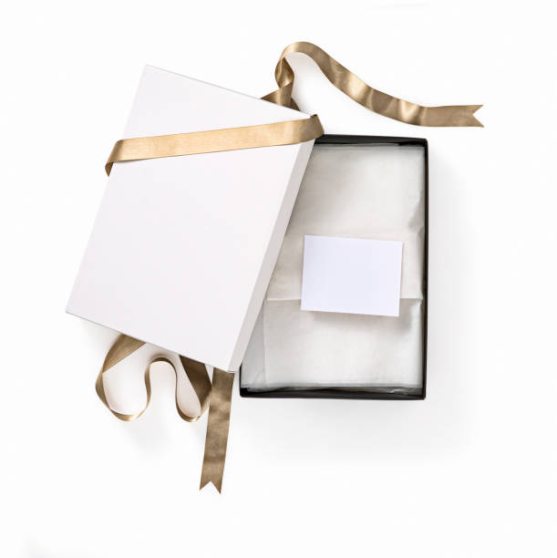 gift box with gold bow - gift voucher or card stock photos and pictures