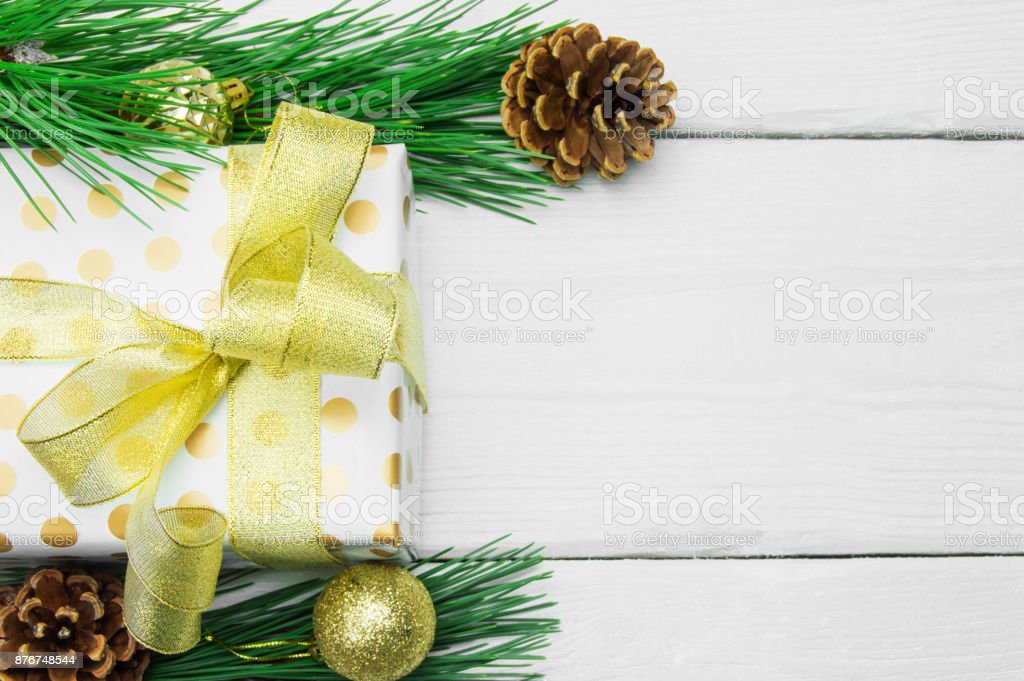 Christmas Tree Bow.Gift Box With Gold Ribbon Bow And Branch Christmas Tree With Cone On White Wooden Vintage Background Stock Photo Download Image Now