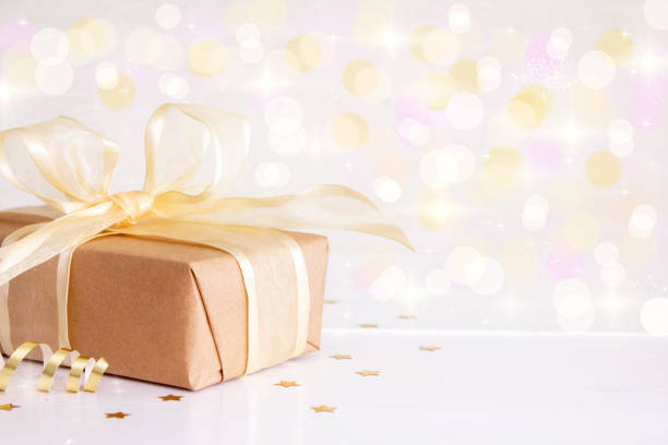Gift box with gold ribbons stock photo