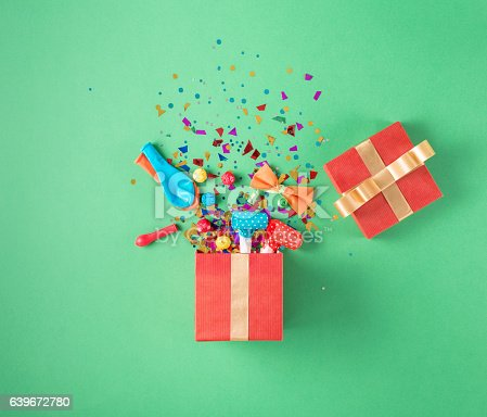 istock Gift box with party confetti, balloons, streamers, noisemakers 639672780