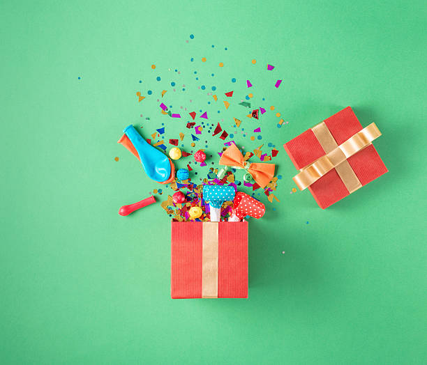 gift box with party confetti, balloons, streamers, noisemakers - astonishment stock photos and pictures