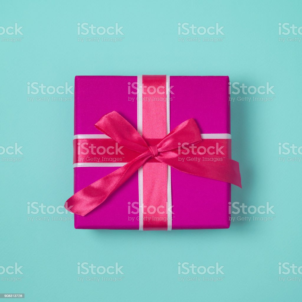 Gift box with pink bow stock photo