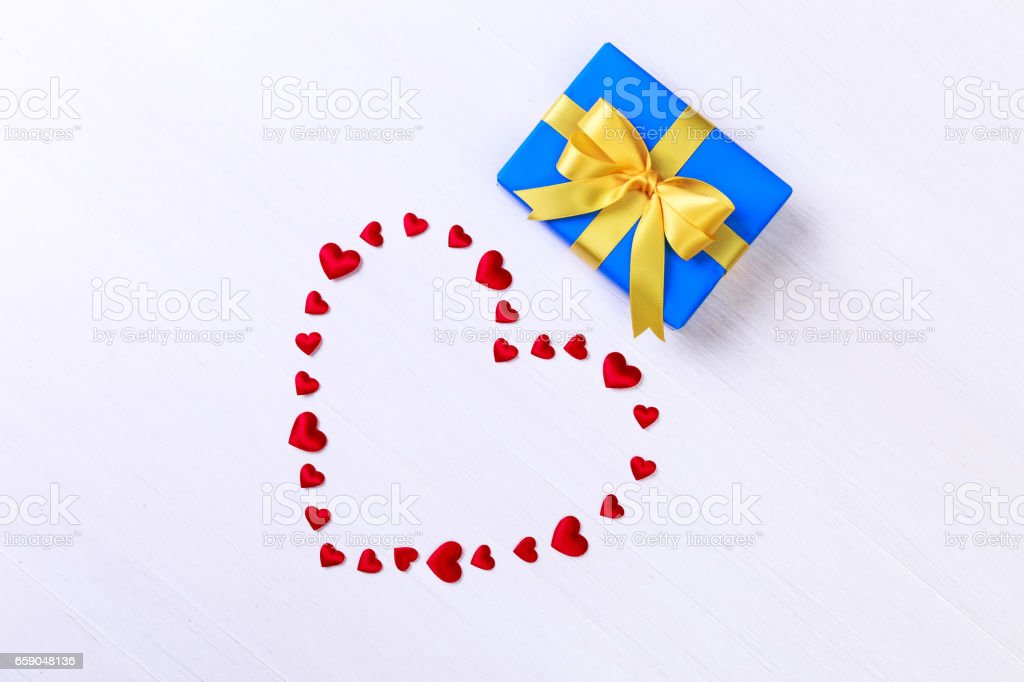 Gift box with red heart. Blue present package. royalty-free stock photo