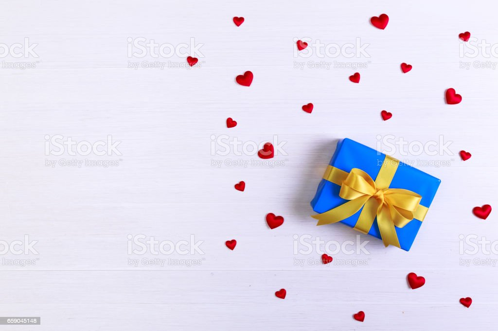 Gift box with red hearts. Blue present package. royalty-free stock photo