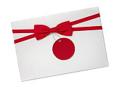 istock Gift box with red ribbon bow and paper tag top view isolated on white background, clipping path included 1042483822