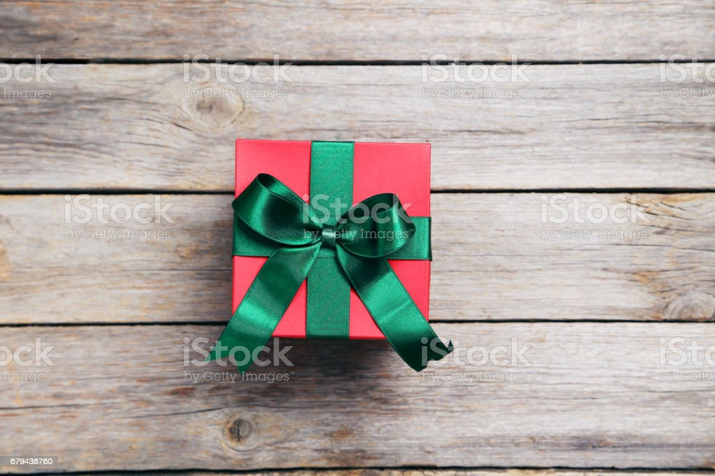 Gift box with ribbon on grey wooden table royalty-free stock photo