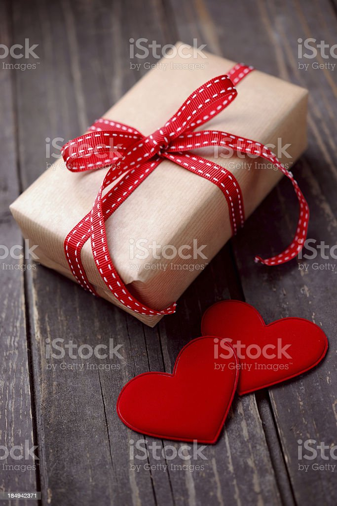 Gift box with two red hearts royalty-free stock photo