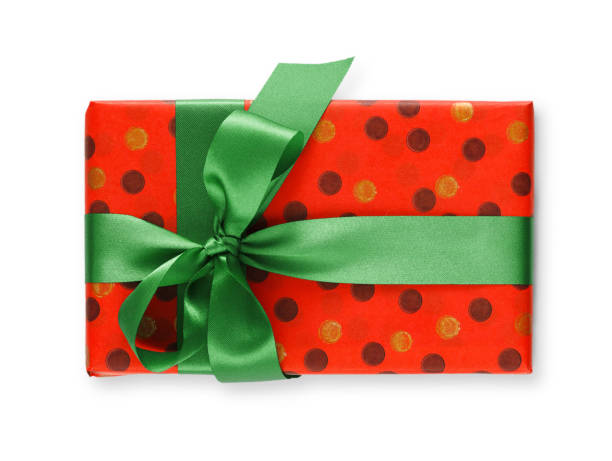 Gift box wrapped in red paper and green ribbon stock photo