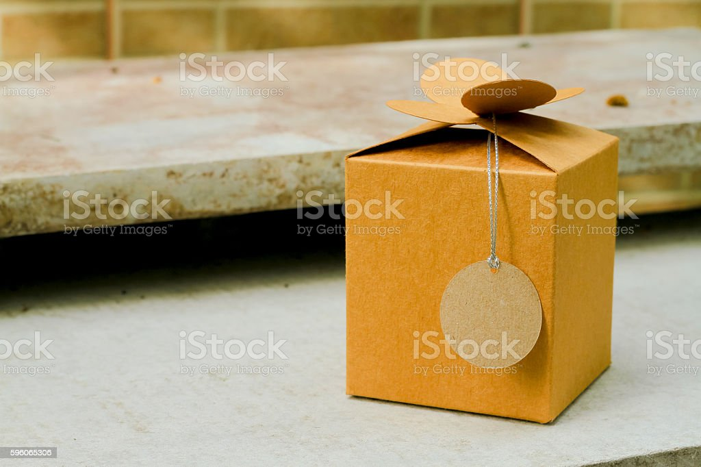 gift box wrapped with simple brown paper isolated on white royalty-free stock photo