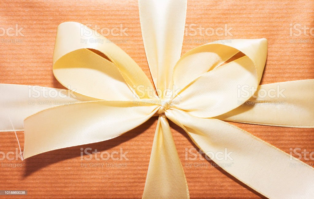 Gift Box Yellow Ribbon And Orange Wrap Paper Stock Photo & More