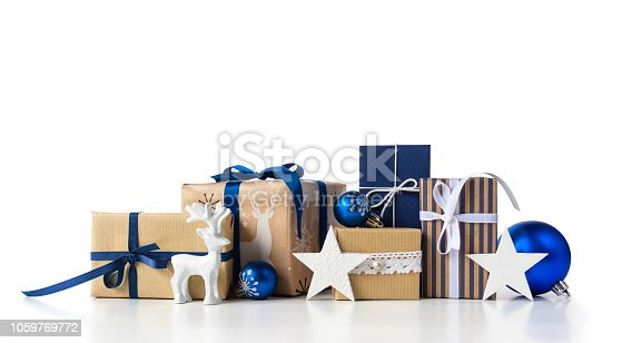 Christmas Gift boxes set with christmas blue balls and baubles and deer on white background.