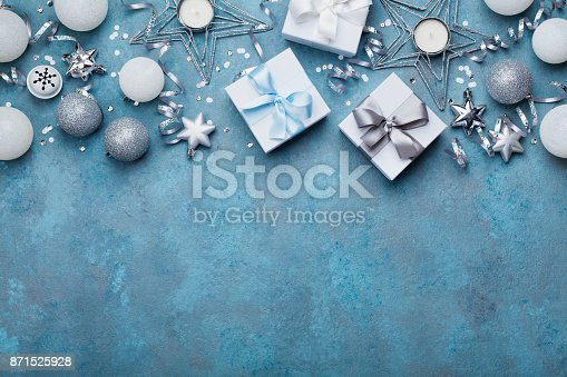istock Gift boxes and christmas decoration on vintage turquoise background top view. Flat lay. 871525928