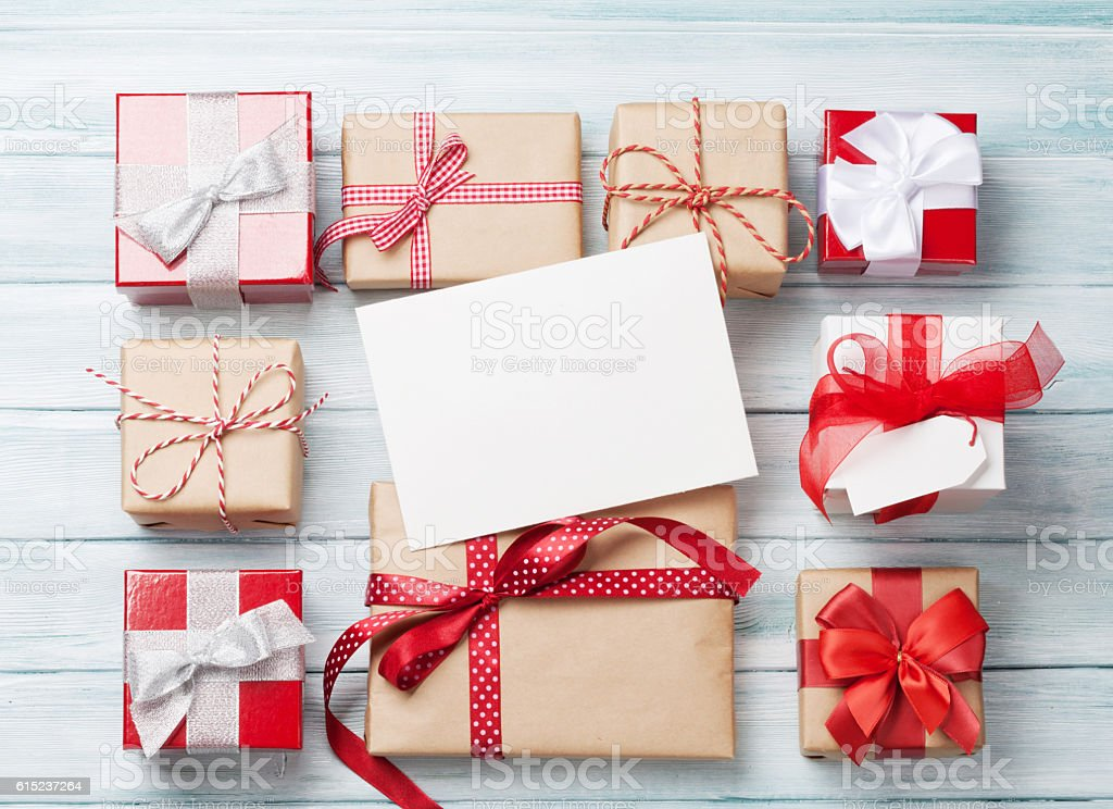 Gift boxes and christmas greeting card Gift boxes and christmas greeting card on wooden table. Top view with copy space Above Stock Photo