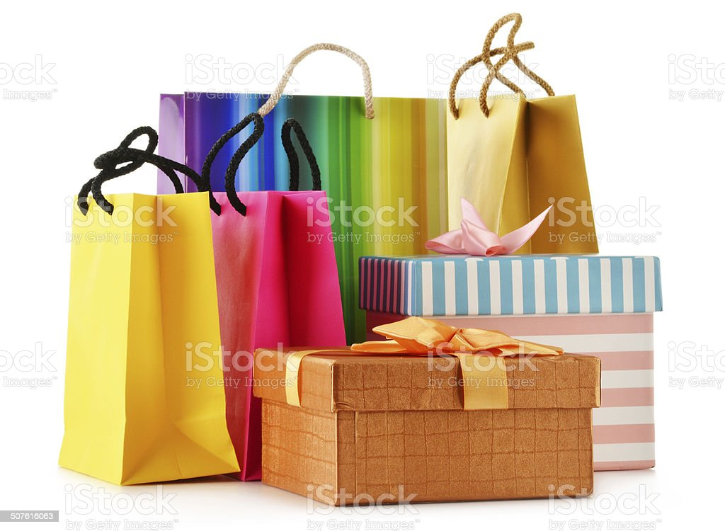 Gift boxes and colorful gift bags isolated on white stock photo