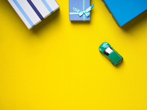 Gift Boxes And Toy Car On Yellow Background Stock Photo - Download Image Now
