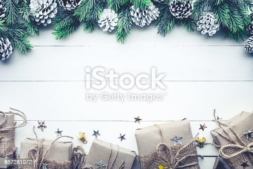 istock Gift boxes collection wrapped in kraft paper with border pine 857281072
