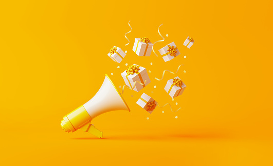 Gift Boxes Coming Out Of A Yellow Megaphone Over Yellow Background - Fotografie stock e altre immagini di Affari