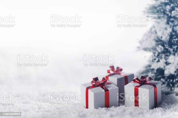 Gift boxes in snow under tree picture id1083395800?b=1&k=6&m=1083395800&s=612x612&h=pw yph5 q1irbwz ree6c0ngfcfm88kiu3zvw3mhx8e=