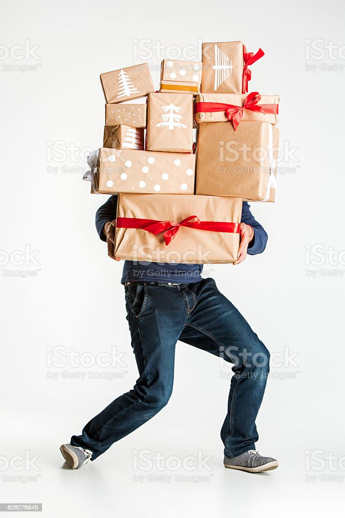 Gift boxes in the hands of young man stock photo