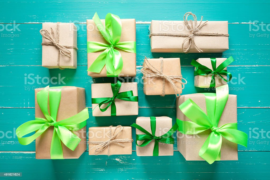 Gift boxes in wrapped paper on turquoise table. This file is cleaned...