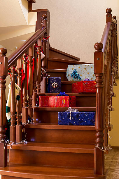 gift boxes laying on stairs. - christmas tree stockfoto's en -beelden