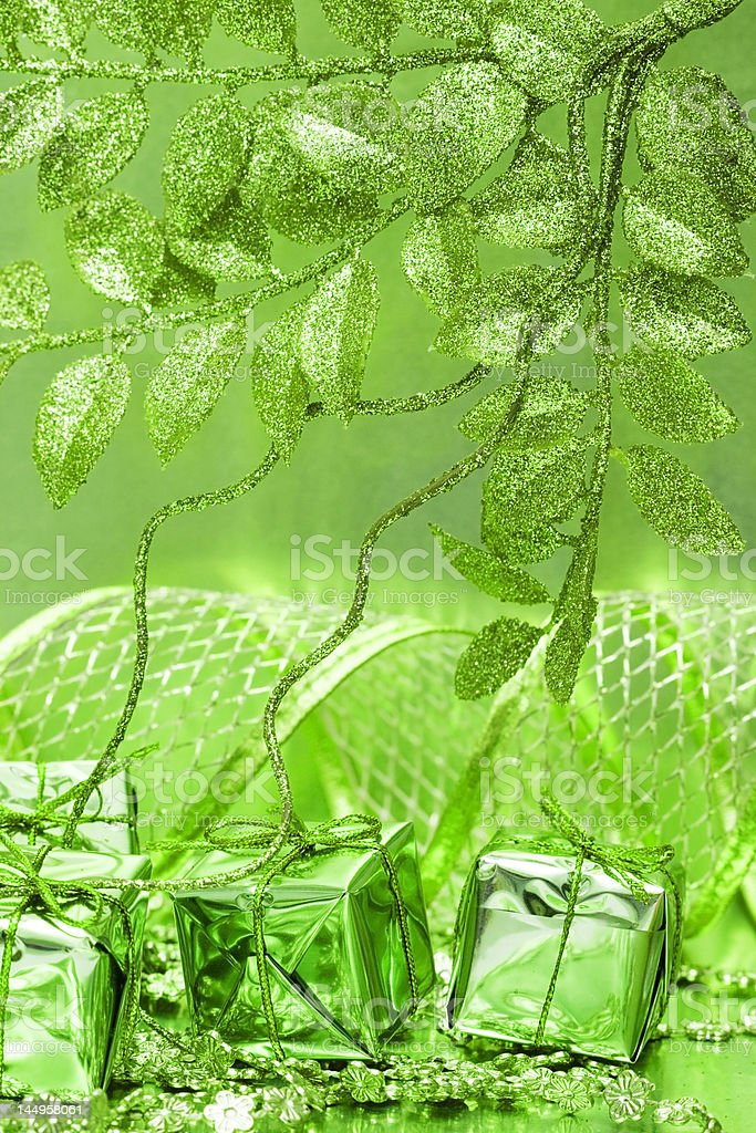 gift boxes on green background with leaves royalty-free stock photo