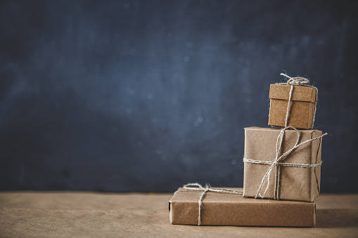 Gift Boxes On Kraft Paper Stock Photo - Download Image Now