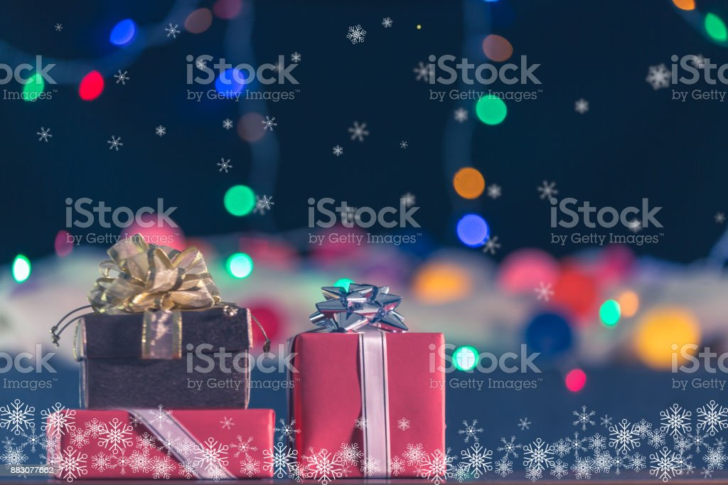 Gift boxes on table with Christmas or New year decorative light...
