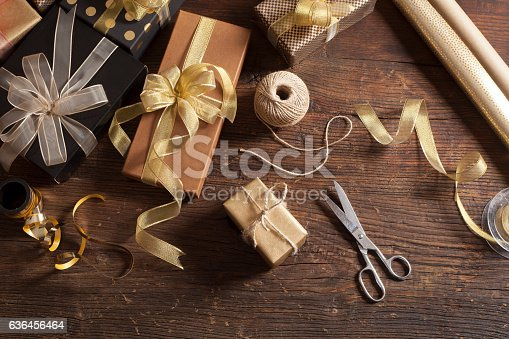 507751629 istock photo Gift boxes on wooden background 636456464