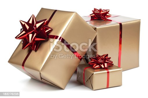 Gold gift boxes with red ribbon on white. This file contains