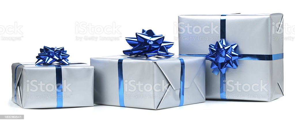 Gift boxes Silver gift boxes with blue ribbon on white. This file contains  Birthday Stock Photo