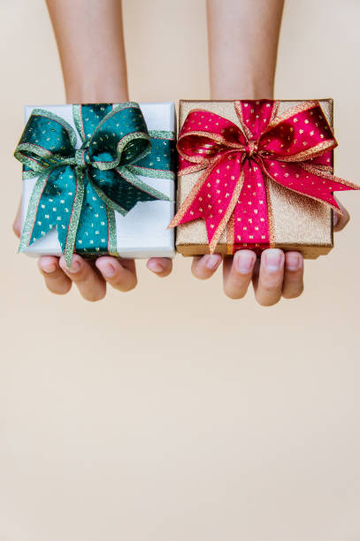 gift boxes red and green box for holiday christmas background , thankgiving  festival 2019 - symmetry stock photos and pictures