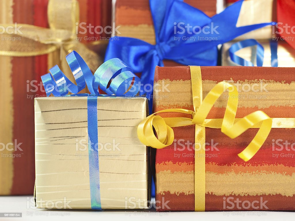 Gift boxes with blue and yellow ribbons royalty-free stock photo