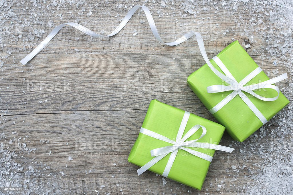 Gift boxes with bow and snowflakes royalty-free stock photo